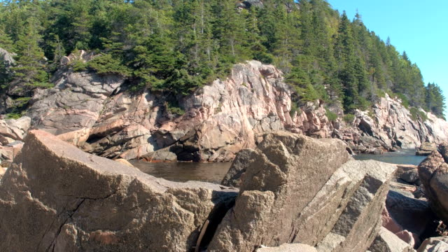 CLOSE UP: Sharp natural volcanic stone and rocky seashore by the northern ocean video