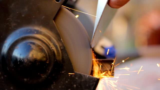 Sharpening garden shovel or spade with a stone grinder video