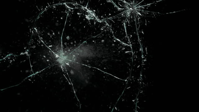 Shatter Mirror Broken Crack Glass Broken cracks glass fracture effect texture isolated abstract black background. Bullet cracked window with big hole screen mirror weapon shot. drinking glass stock videos & royalty-free footage