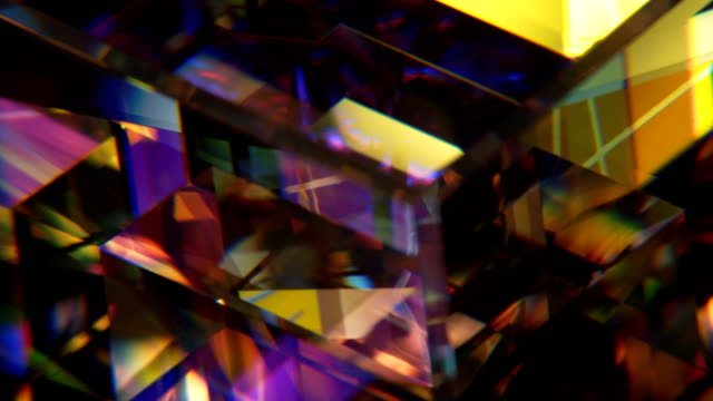 shattered stained glass This 4k macro shot of a rotating collection of stained glass is perfect as a motion background, texture, or visual effect. prism stock videos & royalty-free footage