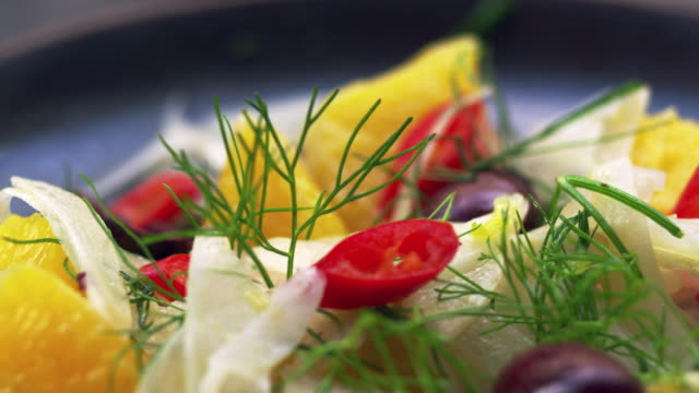 Shaved fennel and orange salad, extreme close up pan video