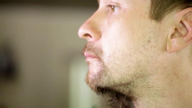 Shaving beard in profile