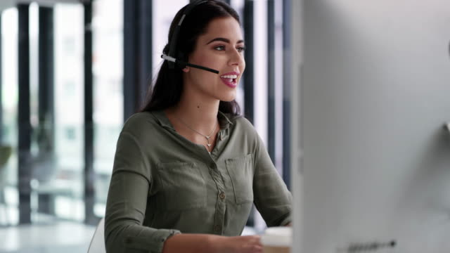 She always goes beyond for her customers 4k video footage of a young call centre agent working on a computer in an office call center stock videos & royalty-free footage