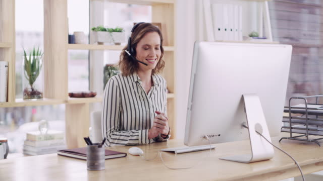 She has proper call centre expertise 4k video footage of an attractive young female call centre agent working in a modern office call centre videos stock videos & royalty-free footage
