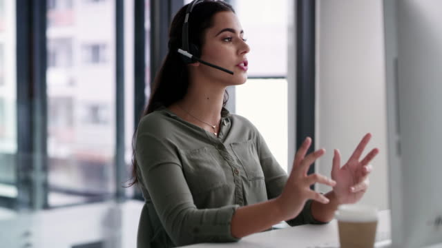 She holds a deep knowledge of her company's products and services 4k video footage of a young call centre agent working on a computer in an office call center stock videos & royalty-free footage