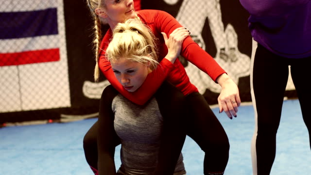 she is teaching mixed martial arts - wrestling stock videos and b-roll footage