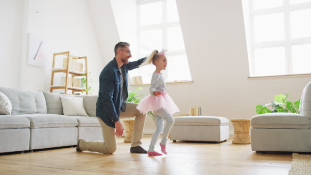 She never misses a chance to dance 4k video footage of a father and daughter dancing together at home ballet dancer stock videos & royalty-free footage