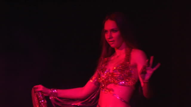 she performs a modern oriental dance video