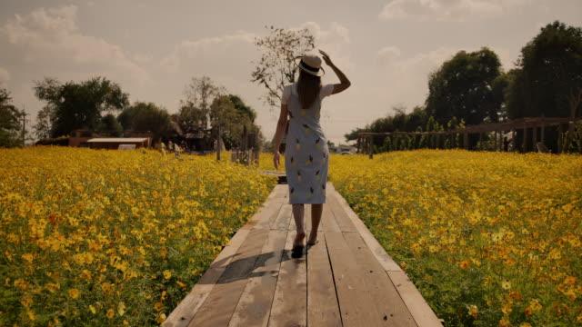 She traveled Yellow flower field garden