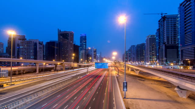 Sheikh Zayed road traffic day to night timelapse and Dubai Metro. Dubai, UAE video