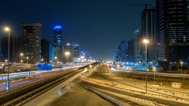 Sheikh Zayed road traffic night timelapse and Dubai Metro. Dubai, UAE video