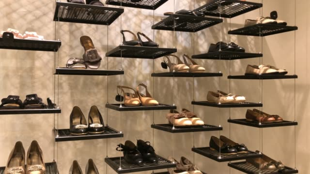shelf of shoes in retail store at shopping mall - shoes fashion stock videos and b-roll footage