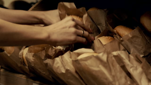 Shelf with bread in paperbags in supermarket video