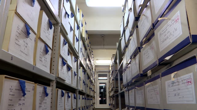 Shelves with boxes in archive. Storage of documents.