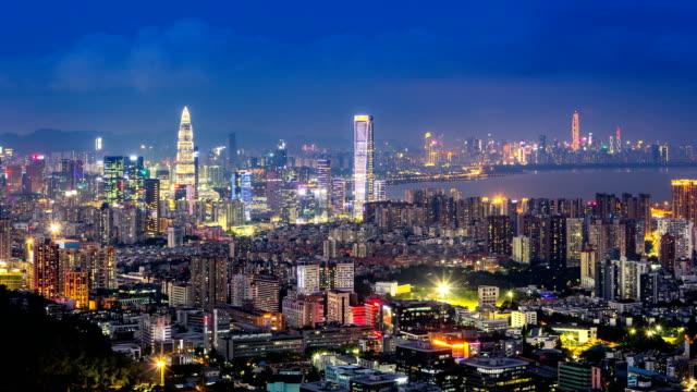 Shenzhen Bay and Houhai city skyline time-lapse from day to night/Shenzhen,China.