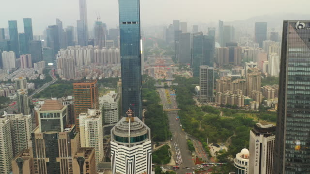 shenzhen city day time downtown aerial panorama 4k china - шэньчжэнь стоковые видео и кадры b-roll