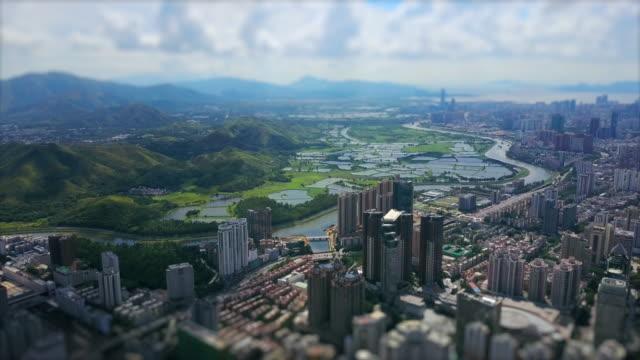 shenzhen cityscape sunny day hong kong border river aerial panorama 4k tilt shift china - элемент здания стоковые видео и кадры b-roll