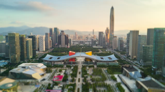 shenzhen cityscape sunset sky downtown city hall aerial panorama 4k tilt shift timelapse china - шэньчжэнь стоковые видео и кадры b-roll