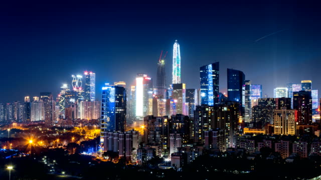 Shenzhen downtown district  skyline from dusk to night/4K Time Lapse Shenzhen downtown district  skyline from dusk to night/4K Time Lapse/zoom out international architecture stock videos & royalty-free footage