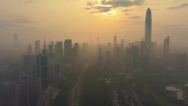 shenzhen urban skyline in misty morning. skyscrapers of futian district. china. aerial view - smog video stock e b–roll