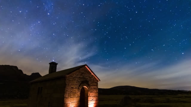 Shepherd house lighted by two candles at night, Saint Antonio Navy, Serra da Estrela Natural Park, Portugal - Timelapse