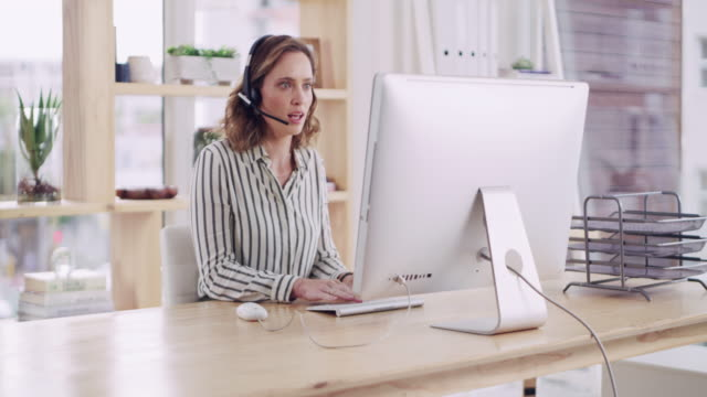 She's a pro at solving customers' problems 4k video footage of an attractive young female call centre agent working in a modern office call centre videos stock videos & royalty-free footage