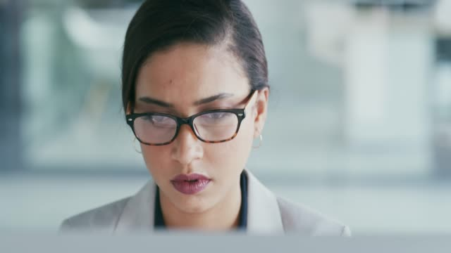 She's feeling the pressure 4k video footage of an attractive young businesswoman looking stressed while working in her office image focus technique stock videos & royalty-free footage