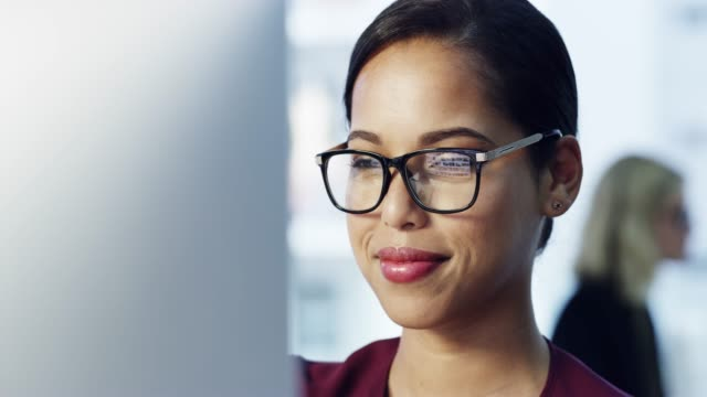 She's focused on getting the job done 4k video footage of an attractive young businesswoman working on her computer in the office brightly lit stock videos & royalty-free footage