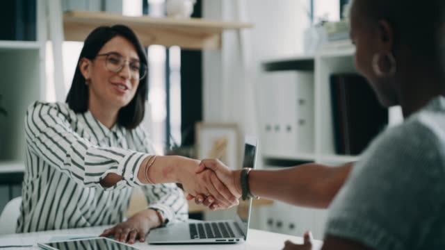 She's got a few questions to ask 4k video footage of two young business colleagues shaking hands during an interview in the office chance stock videos & royalty-free footage