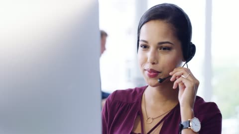She's got solutions yo all of your problems 4k video footage of an attractive young female customer service agent working in the office service stock videos & royalty-free footage