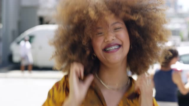 She's got that Friday feeling 4k video footage of an attractive young woman cheering happily while out in the city ecstatic stock videos & royalty-free footage