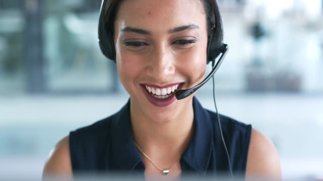 She's happy to help 4k video footage of an attractive young businesswoman working in a call center hands free device stock videos & royalty-free footage