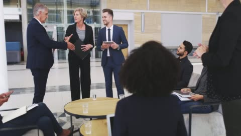 She's just the person we needed on our team 4k video footage of businesspeople shaking hands during a meeting in a modern office agreement stock videos & royalty-free footage