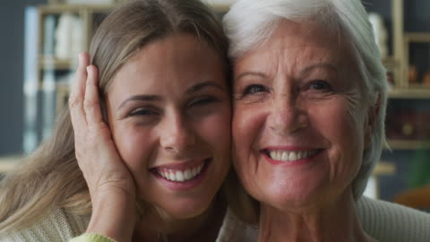 She's my reason for smiling 4k video footage of a young woman and her elderly relative embracing at home daughter stock videos & royalty-free footage