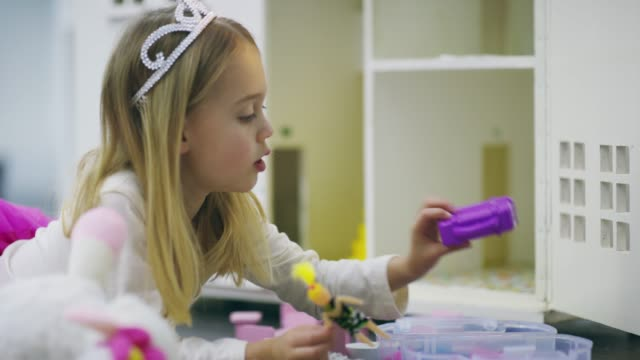 She's quite an imaginative kid 4k video footage of an adorable little girl playing with a dollhouse at home one girl only stock videos & royalty-free footage