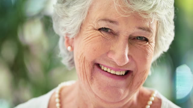 She's still got a little sass! 4k video footage a smiling senior woman winking ethnicity stock videos & royalty-free footage