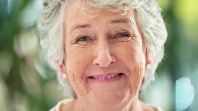 She's still playful! 4k video footage a smiling senior woman front view stock videos & royalty-free footage