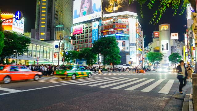 Shibuya District At Night With Crowd Passing Crosswalk Tokyo Japan