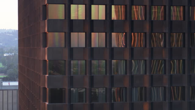Shimmering Reflections in Office Building Windows - Drone Shot video