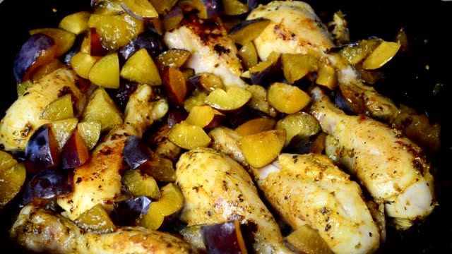Shin of chicken on a cast-iron pan.Preparation process. video