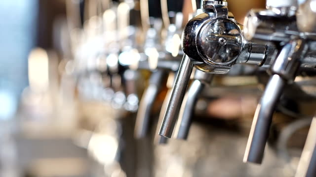 Shining beertaps in craft brewery, draft beverage for real lovers, sport pub