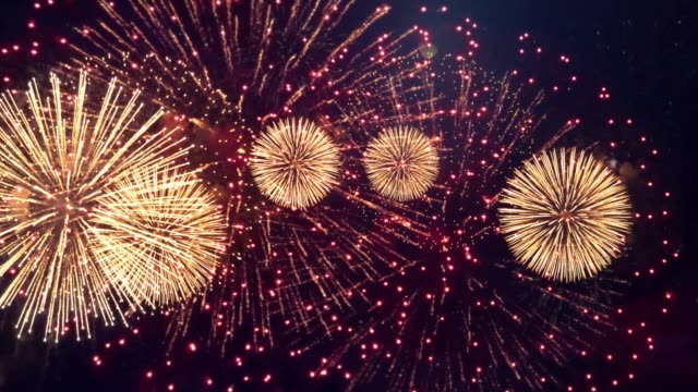 shining fireworks with glowing lights in night sky fireworks show. - luglio video stock e b–roll