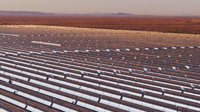 Shining Mirrors at Parabolic Trough Solar Plant in Desert - Aerial