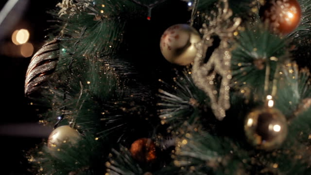 shiny Christmas tree decorated with toys video