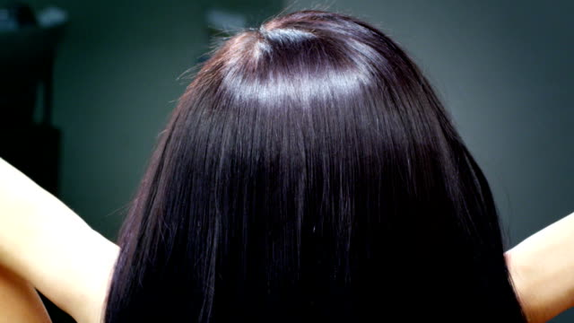 Shiny dark brown hair Young beautiful brunette hair, close up. Recorded by the camera RED. Color correction professionally done. human hair stock videos & royalty-free footage