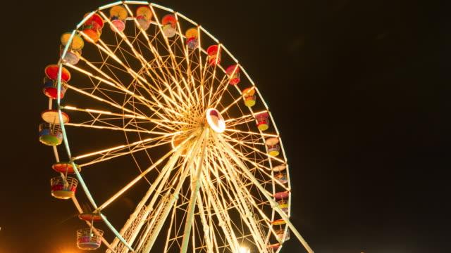 Shiny ferris wheel in the night. video