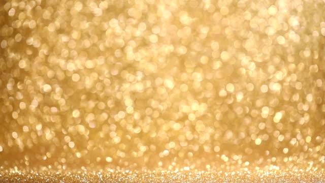 光沢のある黄金色のライトの背景 - 玉虫色点の映像素材/bロール