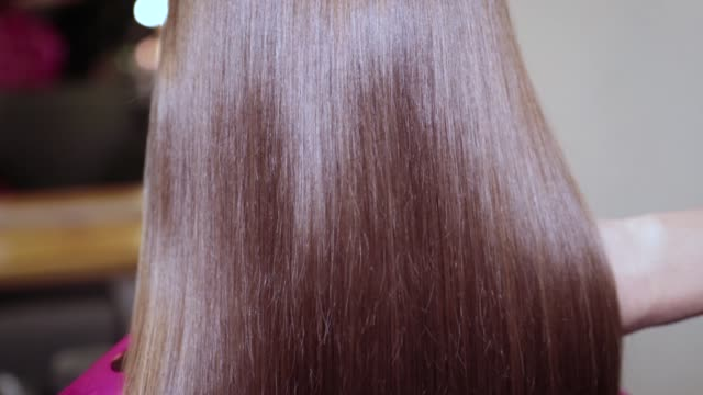 Shiny hair of medium length. The beautiful hair of the child has just been trimmed. Shiny hair of medium length. Salon haircut. Light Brown, Medium Silk Hair highlights hair stock videos & royalty-free footage