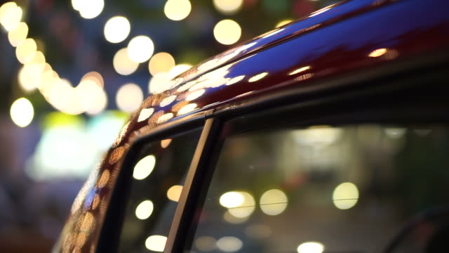 Shiny reflecting holiday Christmas and New Year light on car video