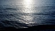 istock shiny reflections of the sun in the blue water. 1213243051